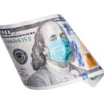 One Hundred Dollar Bill With Medical Face Mask on Benjamin Franklin Isolated on White.